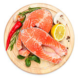 Fresh Raw Salmon Red Fish Steak. Isolated on cutting board Stock Image