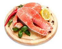 Fresh Raw Salmon Red Fish Steak. Isolated on cutting board Stock Photography