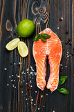 Fresh Raw Salmon Red Fish Steak. On wooden background Stock Photos
