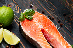 Fresh Raw Salmon Red Fish Steak. On wooden background Royalty Free Stock Images