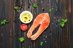 Fresh Raw Salmon Red Fish Steak. On wooden background Stock Photo