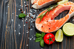 Fresh Raw Salmon Red Fish Steak. On wooden background Royalty Free Stock Photos