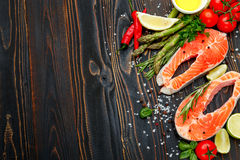 Fresh Raw Salmon Red Fish Steak. On wooden background Royalty Free Stock Photography
