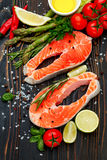 Fresh Raw Salmon Red Fish Steak. On wooden background Royalty Free Stock Photo