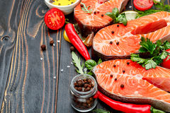 Fresh Raw Salmon Red Fish Steak. On wooden background Stock Image