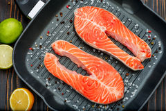 Fresh Raw Salmon Red Fish Steak. On wooden background Royalty Free Stock Image