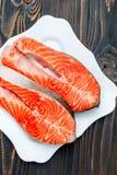 Fresh Raw Salmon Red Fish Steak. On wooden background Stock Photos