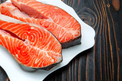 Fresh Raw Salmon Red Fish Steak. On wooden background Stock Photography