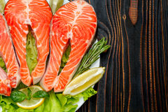Fresh Raw Salmon Red Fish Steak. On wooden background Stock Images