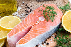 Fresh raw salmon red fish steak. On a wooden table Stock Images