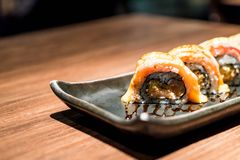 Fresh raw salmon roll sushi. Japanese food style stock photo