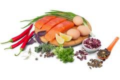 Fresh raw salmon with salt and lemon on. Fresh raw salmon green red closeup market Stock Image