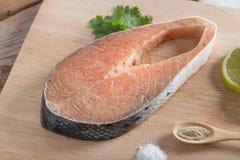 Fresh raw salmon with salt, pepper. Fresh raw salmon with salt, pepper Royalty Free Stock Photos