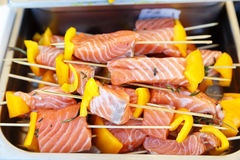 Fresh raw salmon on a skewer Royalty Free Stock Image