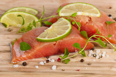 Fresh Raw salmon with spices. Fresh salmon fillet with oregano and lime slices. Selective focus Royalty Free Stock Photo
