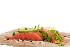 Fresh Raw salmon with spices. Fresh salmon fillet with oregano and lime slices. Selective focus Royalty Free Stock Photos
