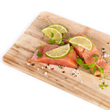 Fresh Raw salmon with spices. Fresh salmon fillet with oregano and lime slices. Selective focus Royalty Free Stock Image