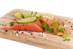 Fresh Raw salmon with spices. Fresh salmon fillet with oregano and lime slices. Selective focus Royalty Free Stock Photography