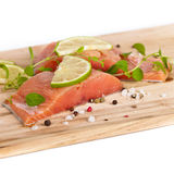 Fresh Raw salmon with spices. Fresh salmon fillet with oregano and lime slices. Selective focus Stock Photos