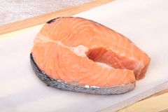 Fresh raw salmon with spices on wooden cutting board. ready for cookin Royalty Free Stock Image
