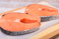 Fresh raw salmon with spices on wooden cutting board. ready for cookin Stock Images