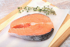 Fresh raw salmon with spices on wooden cutting board. ready for cookin Royalty Free Stock Photography