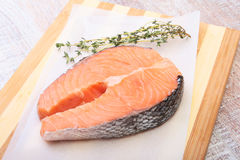 Fresh raw salmon with spices on wooden cutting board. ready for cookin Stock Photography