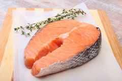 Fresh raw salmon with spices on wooden cutting board. ready for cookin Stock Image