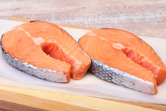 Fresh raw salmon with spices on wooden cutting board. ready for cookin Stock Photos