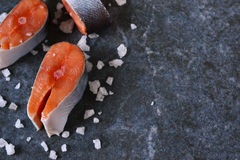 Fresh raw salmon steak. On black marble background Royalty Free Stock Images