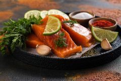 Fresh raw salmon steak. On dark background. Cooking or grill concept. Space for text Stock Photo