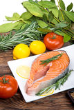 Fresh raw salmon steak with herbs, spices. And vegetables Stock Photo