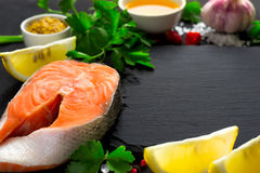 Fresh raw salmon steak And ingredients for preparation. Selectiv. E focus with copy space Stock Photos