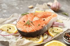 Fresh raw salmon steak with lemon on table. Closeup Royalty Free Stock Photography