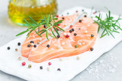 Fresh raw salmon steak with seasonings on board, horizontal Royalty Free Stock Image