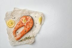 Fresh raw salmon steak with seasonings. On light background, top view Stock Photography