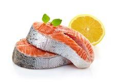 Fresh raw salmon steak slices. On a white background Royalty Free Stock Photo