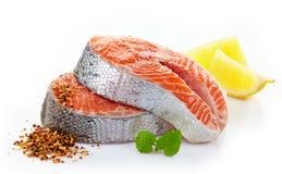 Fresh raw salmon steak slices. On a white background Stock Photo