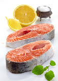 Fresh raw salmon steak slices. On a white background Royalty Free Stock Images