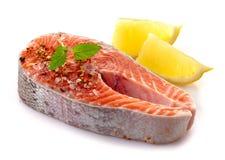 Fresh raw salmon steak slices. On a white background Stock Image