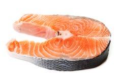 Fresh raw salmon steak slices. Fresh raw salmon steak slices on a white background Royalty Free Stock Images