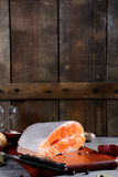 Fresh raw Salmon steak slices on wooden background. Seafood Stock Images