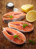 Fresh raw salmon steak slices. On wooden cutting board Royalty Free Stock Image