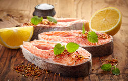 Fresh raw salmon steak slices. On wooden cutting board Stock Image