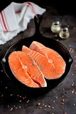 Fresh raw salmon steaks in a cast-iron frying pan. Tasty food Stock Photo
