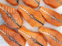 Fresh raw salmon steaks on ice. At the market Stock Images