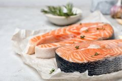 Fresh raw salmon steaks on table. Closeup Stock Photos
