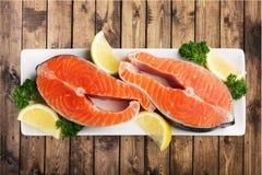 Fresh raw salmon on white plate. Fresh raw salmon green red closeup market Royalty Free Stock Photos