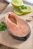 Fresh raw salmon on wood board. Fresh raw salmon on wood board Stock Photos
