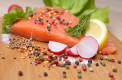 Fresh raw salmon on wood. Fresh raw salmon ready to cook Royalty Free Stock Photos